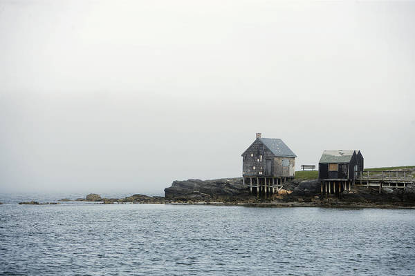 Cabin Photograph - Rustic Cabin On Stilts On Rocky Shore by Gillham Studios