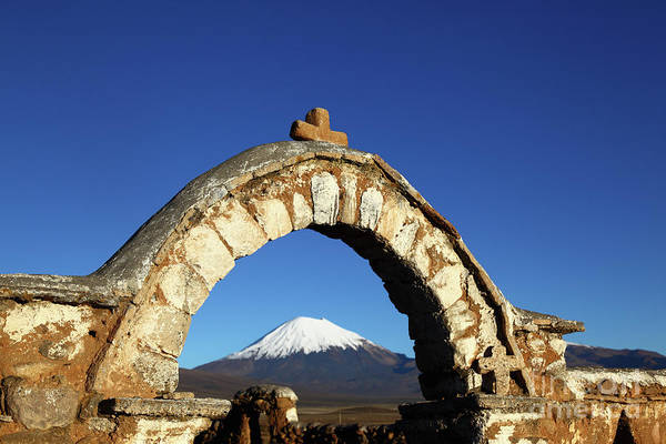 Photograph - Rustic Church Entrance Archway And Parinacota Volcano Bolivia by James Brunker