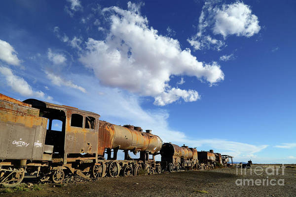Photograph - Rusting Steam Trains In The Desert Bolivia by James Brunker