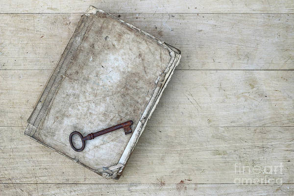 Old Wall Art - Photograph - Rusty Key On The Old Tattered Book by Michal Boubin