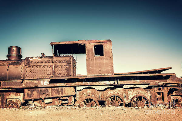 Wall Art - Photograph - Rusty Train In Uyuni, Bolivia by Delphimages Photo Creations