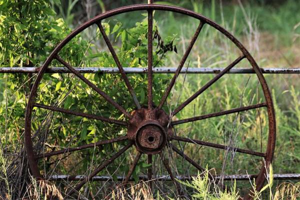 Photograph - Rusty Wagon Wheel On Fence by Sheila Brown