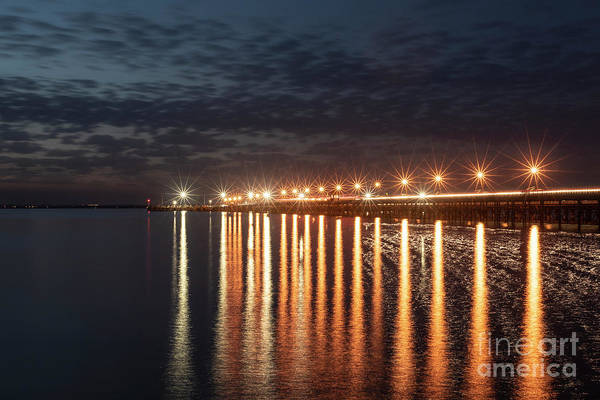 Photograph - Ryde Pier At Sunset With Light Reflections by Clayton Bastiani