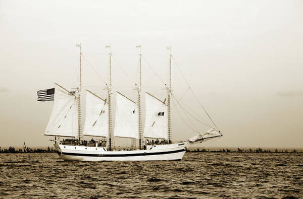 Photograph - Sail Boat With American Flag by Marilyn Hunt