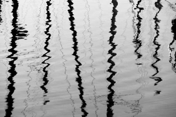 Photograph - Sailboat Mast Reflections In Black And White by Patricia Strand