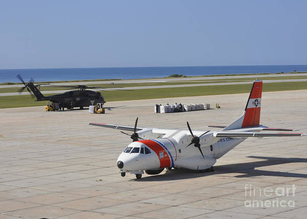Photograph - Sailors Load Disaster Relief Supplies by Stocktrek Images