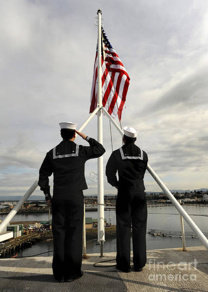Wall Art - Photograph - Sailors Raise The National Ensign by Stocktrek Images