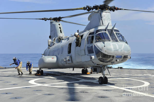 Helicopter Painting - Sailors Secure A Helicopter To The Deck by Celestial Images