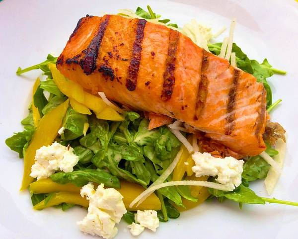 Photograph - Salmon Arugula Salad With Mango And Goat Cheese by Polly Castor