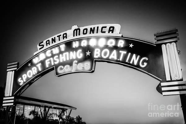 Santa Monica Pier Photograph - Santa Monica Pier Sign Black And White Photo by Paul Velgos