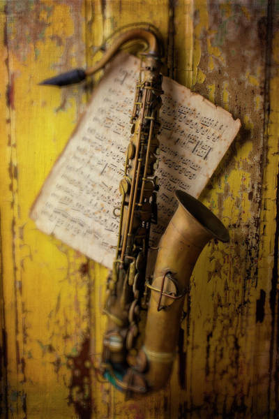 Wall Art - Photograph - Saxophone Hanging On Old Wall by Garry Gay