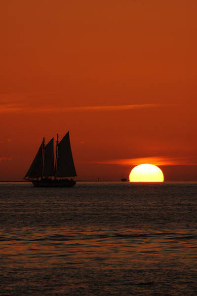 Photograph - Schooner In Red Sunset by Susanne Van Hulst