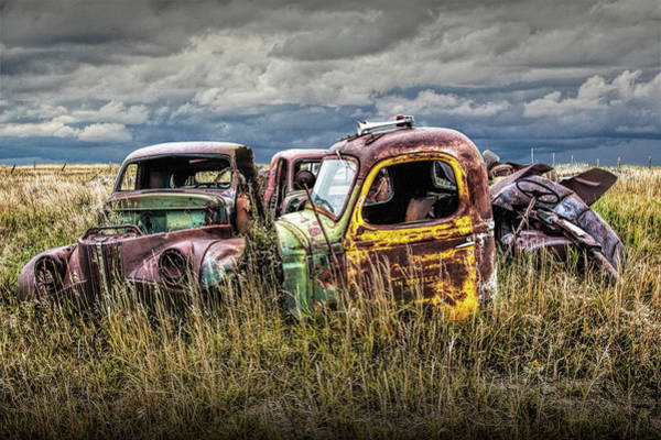 Photograph - Scrapyard Of Old Trucks Abandoned In A Prairie Field by Randall Nyhof