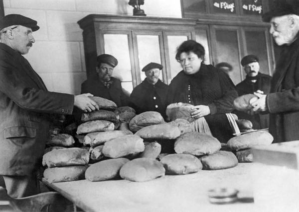 Municipality Photograph - Selling Bread In France by Underwood Archives