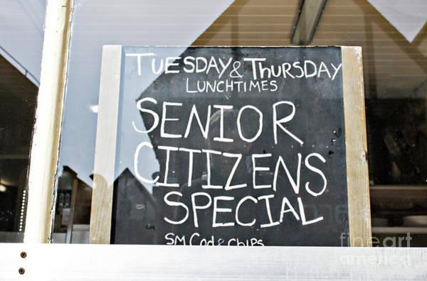 Wall Art - Photograph - Senior Citizens' Offer by Tom Gowanlock