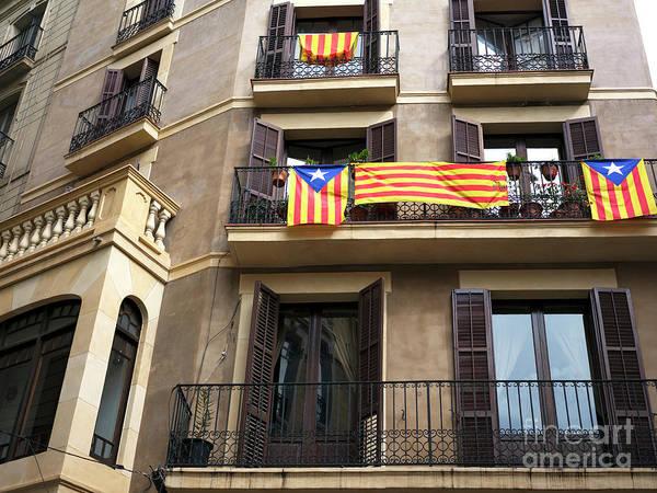 Photograph - Senyera Estelada Hanging In Barcelona by John Rizzuto
