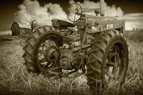 Photograph - Sepia Toned Old Farmall Tractor In A Grassy Field by Randall Nyhof