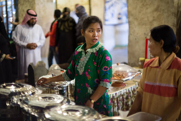 Photograph - Serving Food In Doha Souq by Paul Cowan