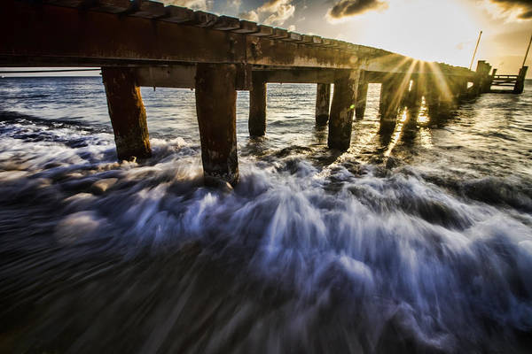 Photograph - Setting Sun And Wave Action By A Pier by Sven Brogren