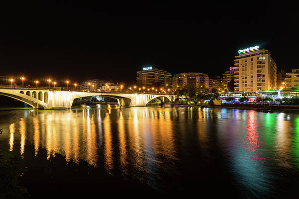 Photograph - Seville Night Magic - Triana Multicolored Reflections Shimmering In Guadalquivir River by Georgia Mizuleva