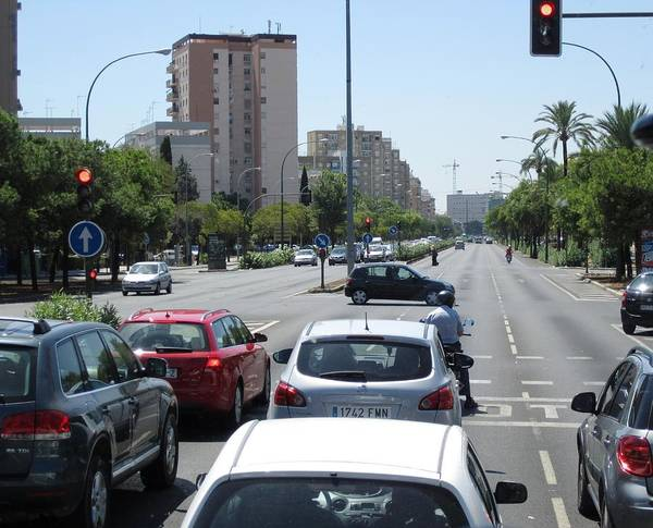 Photograph - Seville Street Intersection Scene And High Rise Buildings Spain by John Shiron