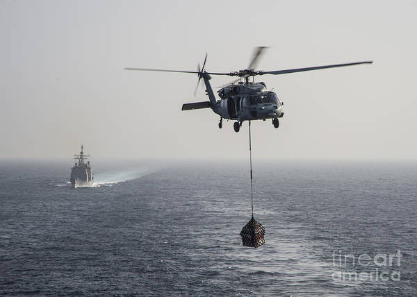 Bryan Painting - Sh-60 Sea Hawk Helicopter  Transports Supplies by Celestial Images