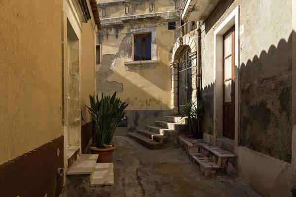 Photograph - Shabby Chic - Cool Shadows Highlight Crumbling Walls In A Tiny Italian Lane by Georgia Mizuleva