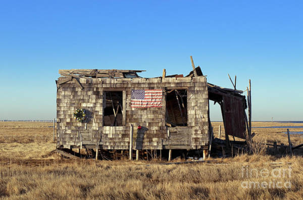 Dilapidation Wall Art - Photograph - Shack With American Flag by John Greim