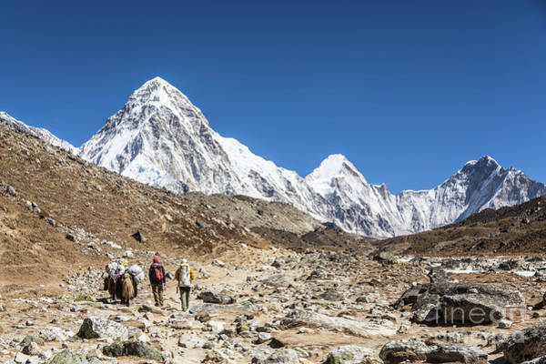 Photograph - Sherpas And Their Yak Walking Toward Everest Base Camp by Didier Marti