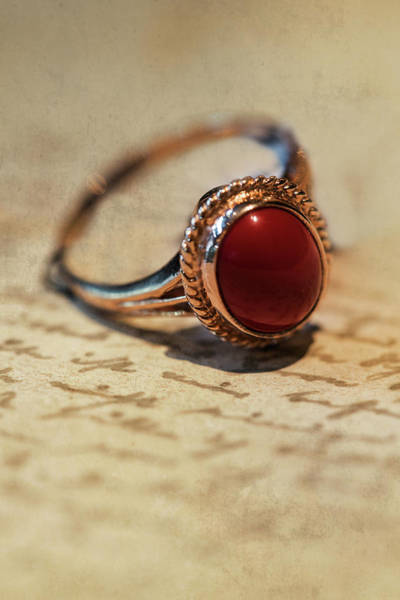 Wall Art - Photograph - Shiny Ring With Dark Red Stone by Jaroslaw Blaminsky