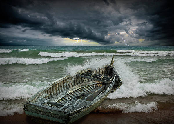 Photograph - Shipwrecked Wooden Boat Amidst Crashing Waves by Randall Nyhof