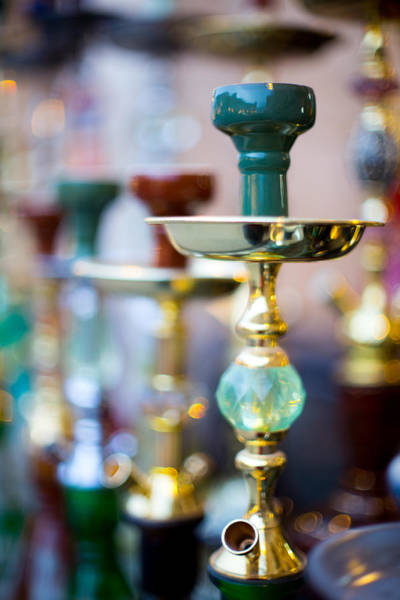 Photograph - Shisha Pipes Lined Up In A Doha Souq by Paul Cowan