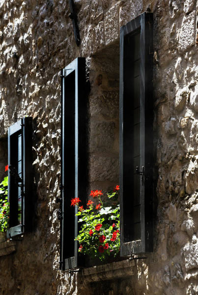 Photograph - Shuttered Window With Red Geranium, Saint Paul De Vence, France. by Maggie McCall