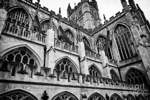 Wall Art - Photograph - Side View Looking Up At Flying Buttresses, Battlements, Pinnacles And Parapets Of Gothic Bath Abbey  by Joe Fox