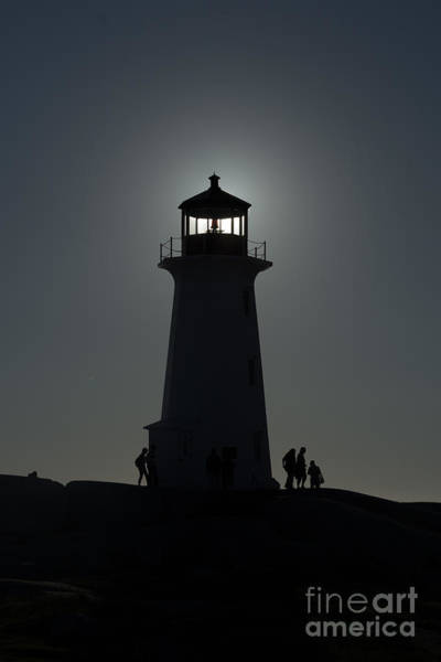 Photograph - Silhouette Of Lighthouse With Sun by Dan Friend