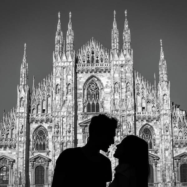 Photograph - Silhouette Of Young Couple Kissing In Front Of Milan's Duomo Cathedral by Alexandre Rotenberg