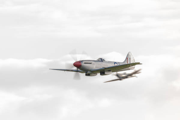 Photograph - Silver Spitfire In A Cloudy Sky by Gary Eason