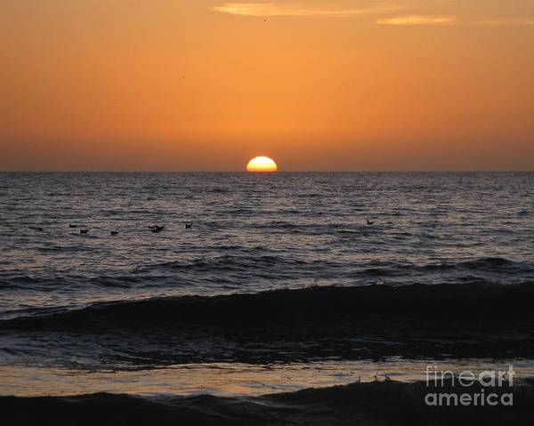 Tequila Sunrise Photograph - Sinking Sun - Setting Over Waves Silhouette Under Orange Sky by Sylvie Marie