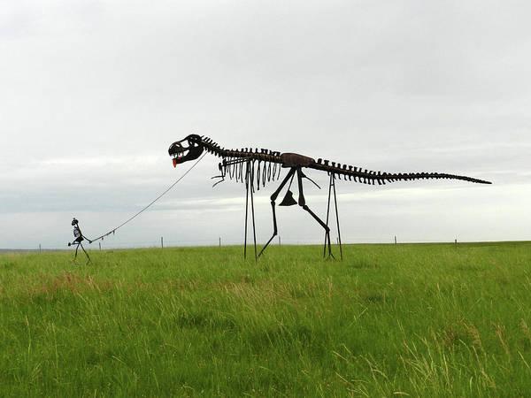 Skeletal Man Walking His Dinosaur Statue Art Print