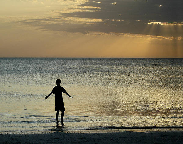 Photograph - Young Boy Skipping Stones At Bonita Beach by Ginger Wakem