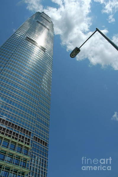 Wall Art - Photograph - Skyscraper And Street Lamp With Cloudy Sky In Hong Kong by Sami Sarkis