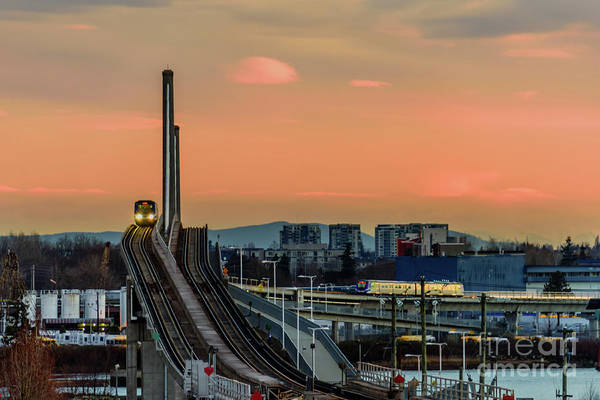 Wall Art - Photograph - Skytrain Canada Line Crosses A Bridge In Vancouver, Canada. by Viktor Birkus