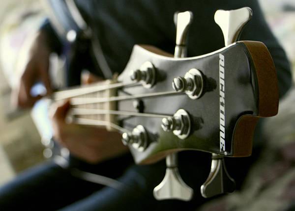 Fret Board Photograph - Slapping The Bass Guitar by Daniel Hagerman