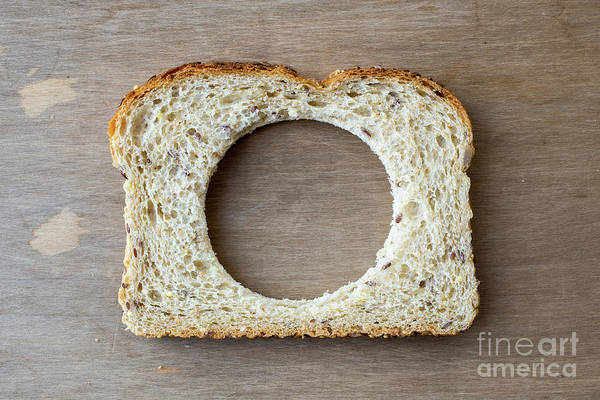 Wall Art - Photograph - Slice Of Bread With Missing Center by Edward Fielding