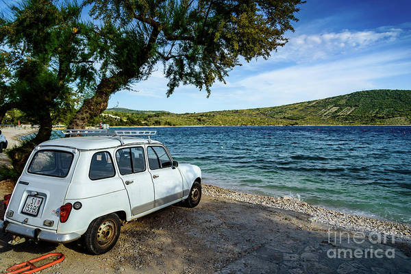Photograph - Small Old Car Under Tree On The Adriatic In Primosten, Croatia by Global Light Photography - Nicole Leffer