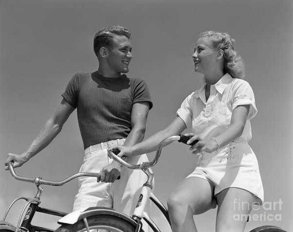 Photograph - Smiling Couple On Bikes, C.1930-40s by H. Armstrong Roberts/ClassicStock