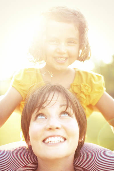 Summer Photograph - Smiling Mother Holding Daughter by Gillham Studios