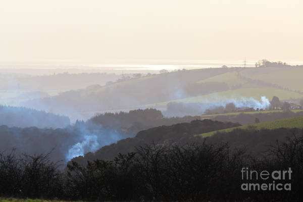 Photograph - Smoke Rising On Hilly Hazy Landscape by Peter Noyce