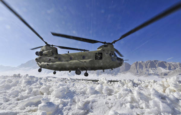 Ch Wall Art - Photograph - Snow Flies Up As A U.s. Army Ch-47 by Stocktrek Images