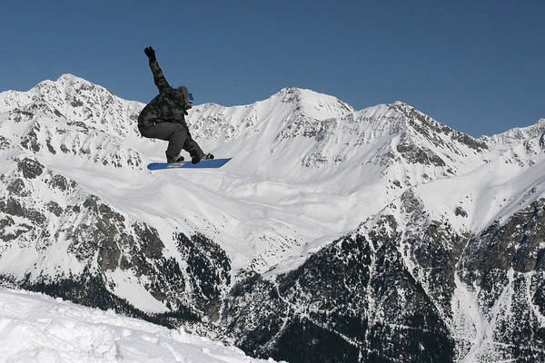 Photograph - Snowboarder Indy Grab Switzerland by Pierre Leclerc Photography